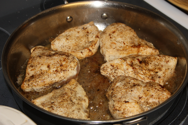 chicken browning in a pan
